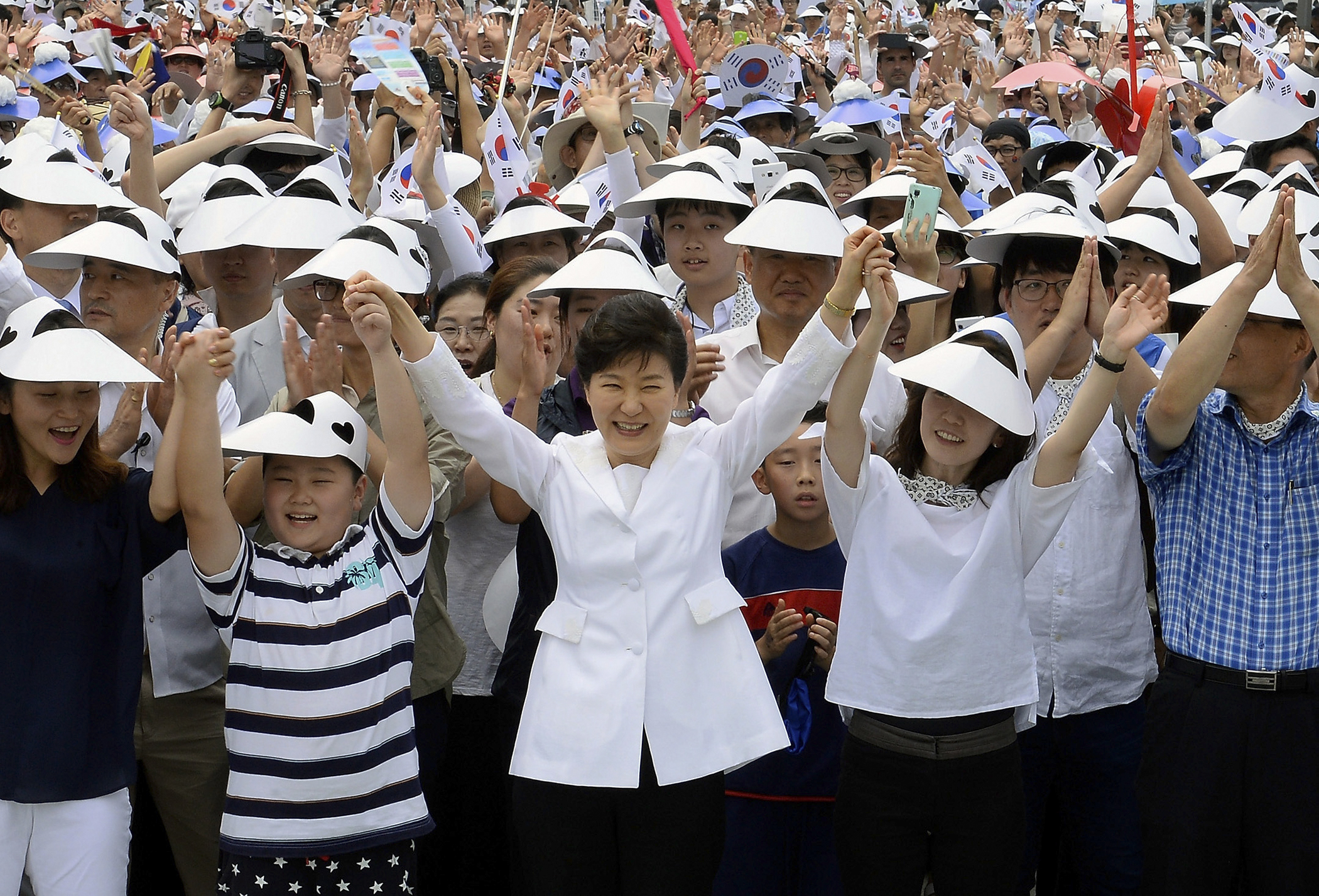 South Korean President Park Geun-Hye gives three cheers during a ceremony to celebrate the 70th Independence Day on August 15, 2015 in Seoul, South Korea. Korea was liberated from Japan's 35-year colonial rule on August 15, 1945 at the end of World War II.