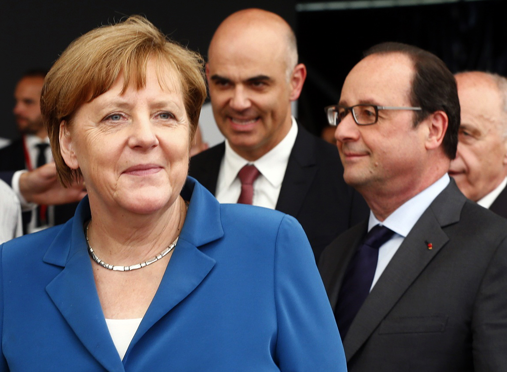 (L-R) German Chancellor Angela Merkel, Swiss Interior Minister Alain Berset and French President Francois Hollande arrive in Pollegio for the opening ceremony of the NEAT Gotthard Base Tunnel, the world's longest and deepest rail tunnel, Switzerland June 1, 2016.