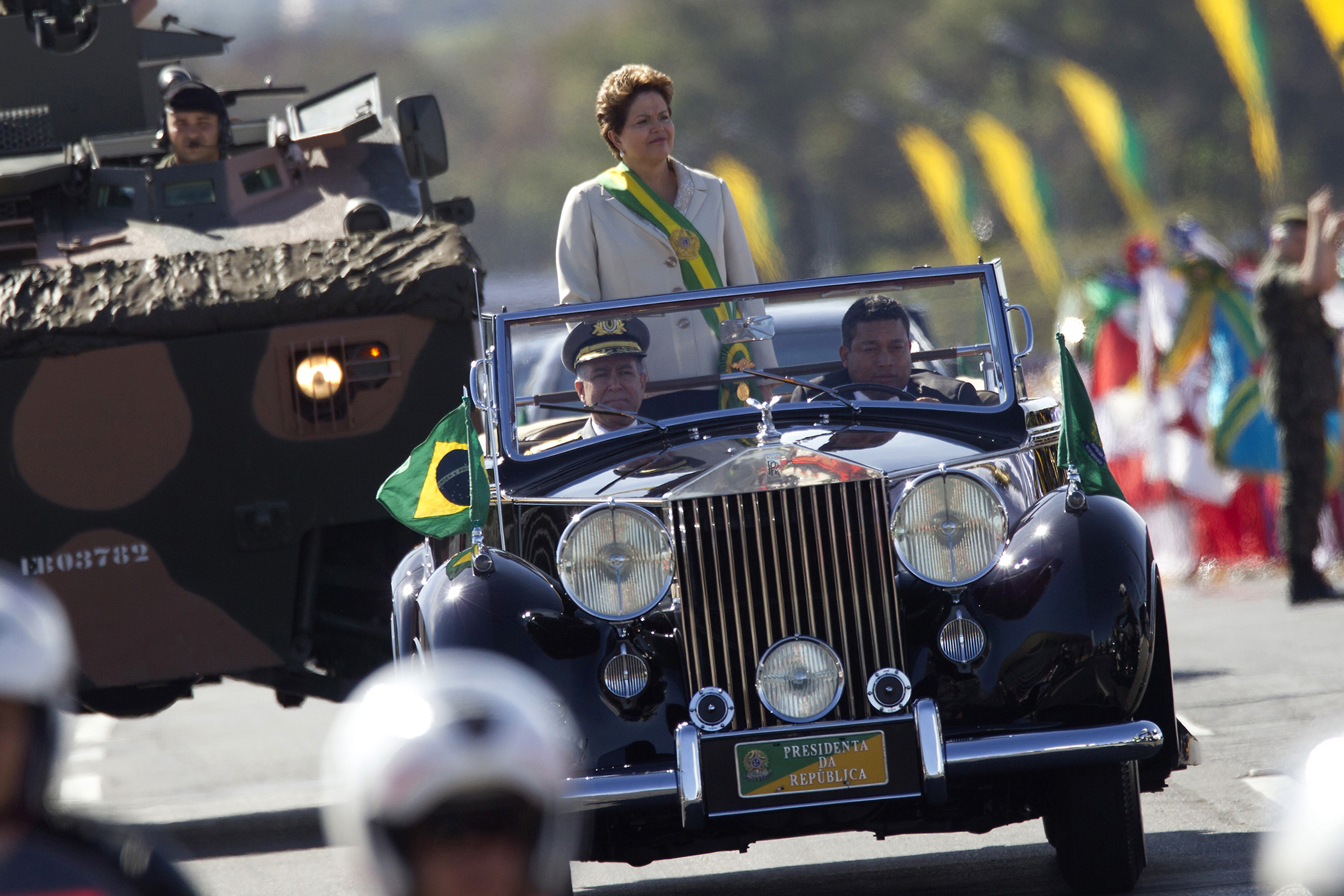 Brazil's President Dilma Rousseff stands in a vehicle during a civic-military parade commemorating of Brazilian independence Day September 7, 2012.