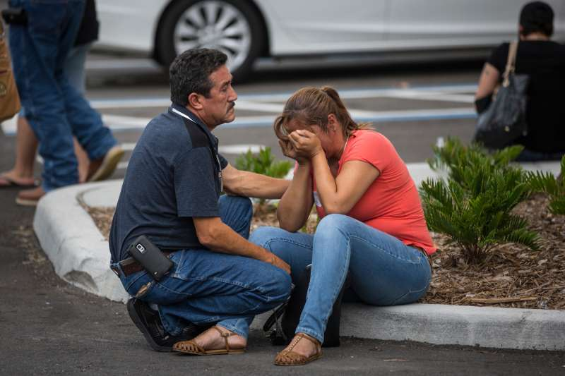 Friends and family grieve after a list of hospitalized victims was released, implying the death of those who weren't on the list and hadn't been heard from, outside a Hampton Inn & Suites hotel near the Orlando Regional Medical Center in Orlando, Fla., Sunday, June 12, 2016. A gunman opened fire inside a crowded nightclub early Sunday, before dying in a gunfight with SWAT officers, police said.