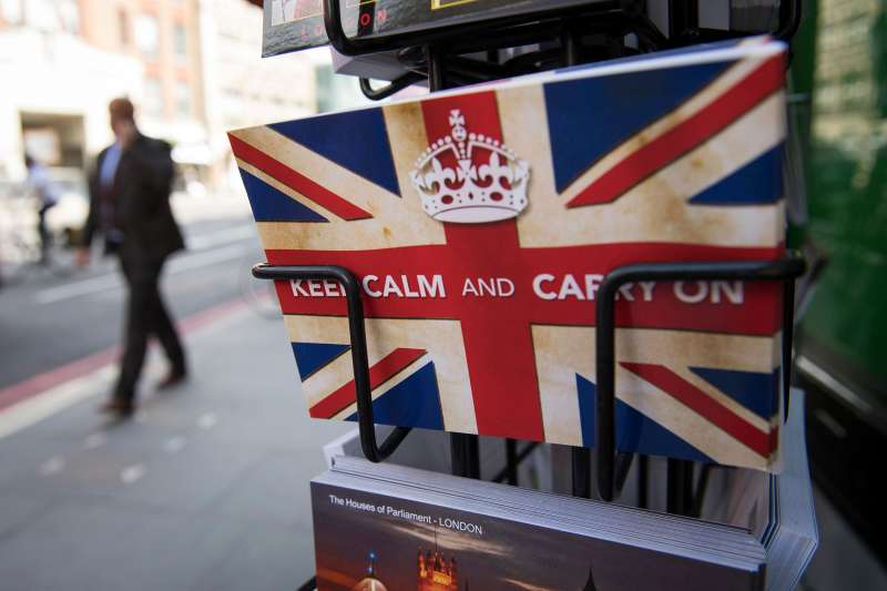 Postcards featuring the World War II British slogan  Keep Calm and Carry On  are seen outside a newsagents in London, on June 24, 2016.                Britain voted to break away from the European Union on June 24, toppling Prime Minister David Cameron and dealing a thunderous blow to the 60-year-old bloc that sent world markets plunging.