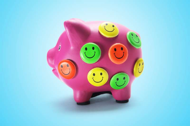 piggy bank with smiley buttons all over it