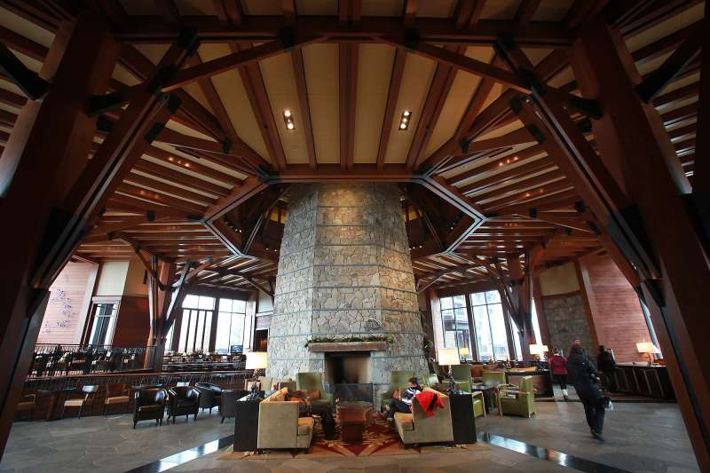 SOUTH LAKE TAHOE- NOVEMBER 16 2012: Cozy seating areas surround the stone fireplace column at the Ri