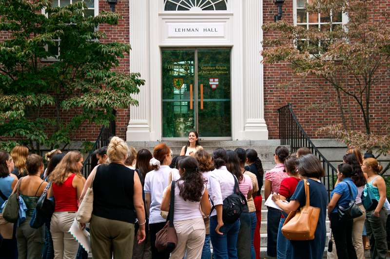 Sophomore student leads introductory tour on steps of Lehmen Hall Old Harvard Yard Harvard University Cambridge MA