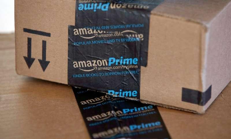This June 4, 2014 photo shows Amazon.com boxes in Phoenix.