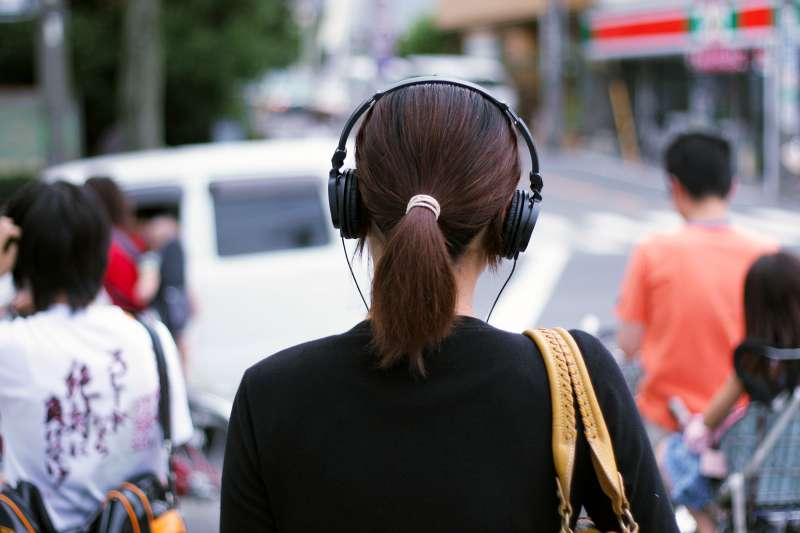 woman wearing headphones on street