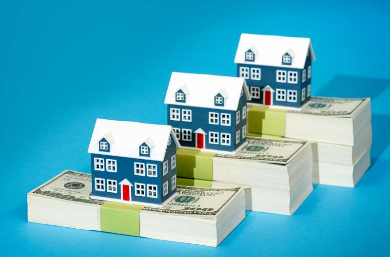 houses on stacks of cash