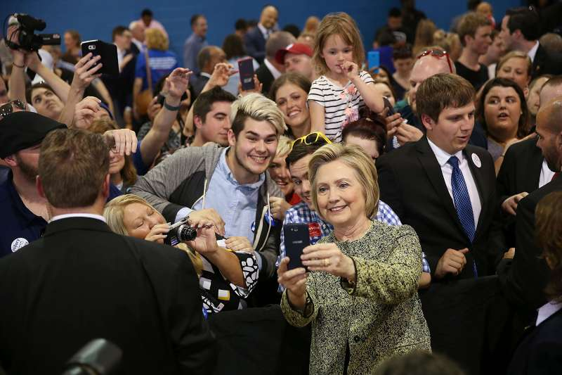 Democratic presidential candidate Hillary Clinton takes cell phone photographs with people during a campaign stop at the Douglass Park Gynasium on May 1, 2016 in Indianapolis, Indiana.