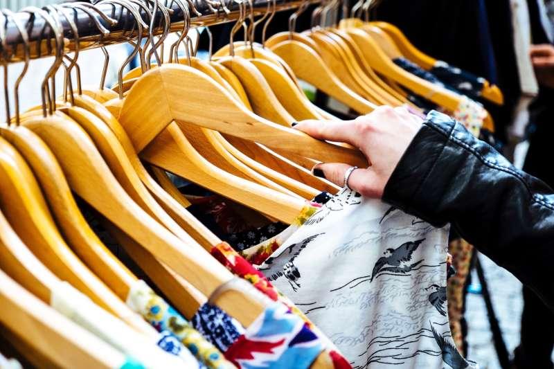 hand on clothing rack