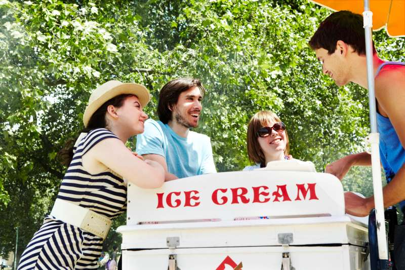 Friends buying ice cream from the vendor