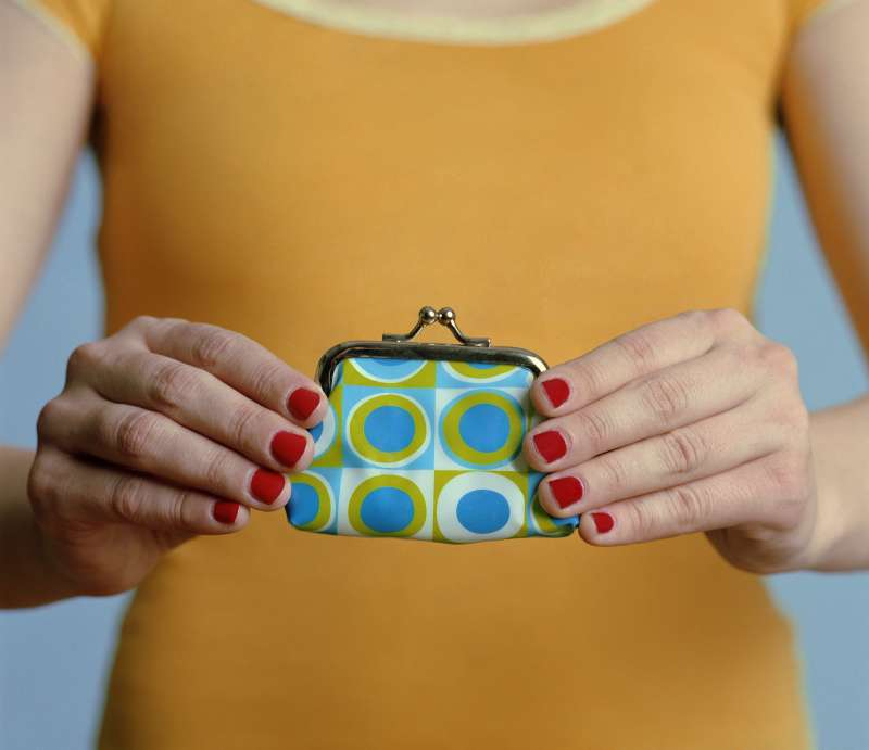 Woman holding purse, close-up