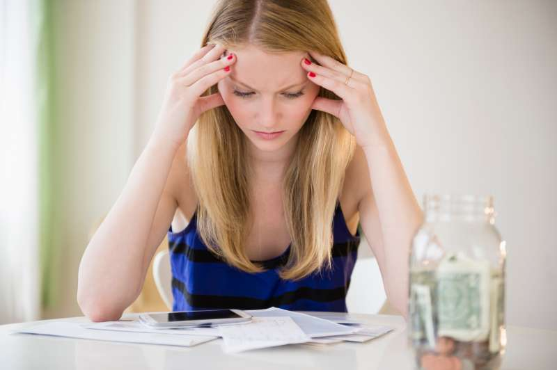 Woman frustrated with bills