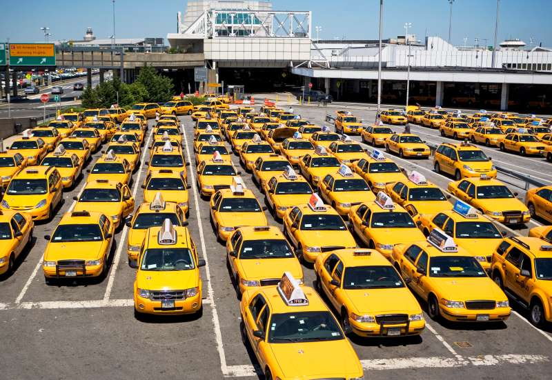 Rows of taxis waiting at airport