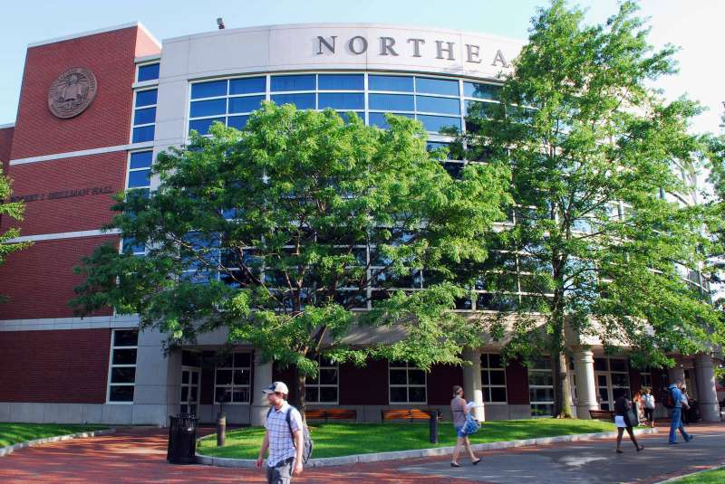 Students walk by Shillman's Hall on the Northeastern Univers