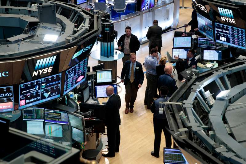 Traders and financial professionals work on the floor of the New York Stock Exchange (NYSE), July 12, 2016 in New York City.