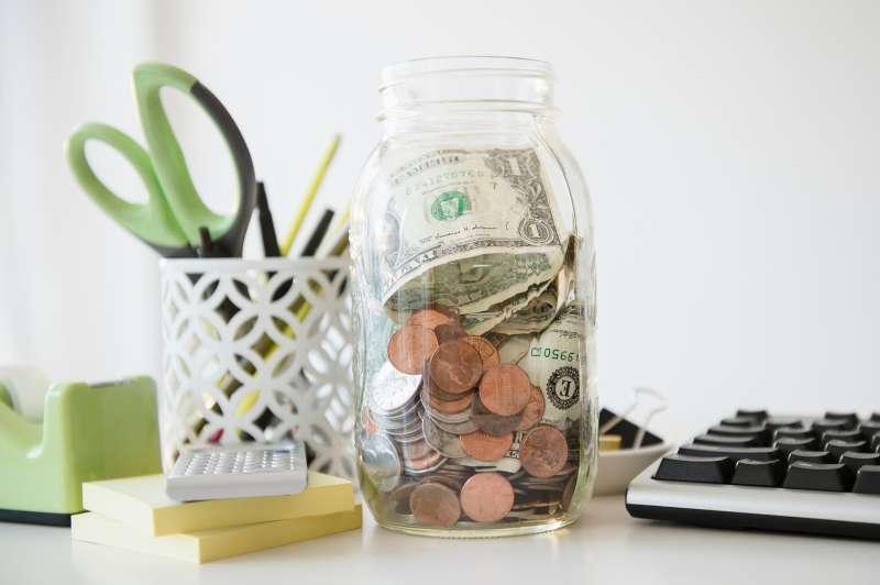 jar of money on desk