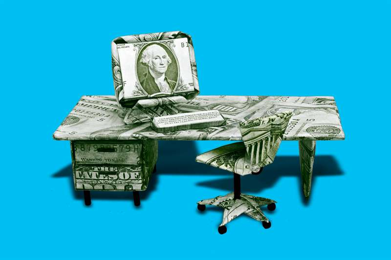 office chair and desk made out of money.