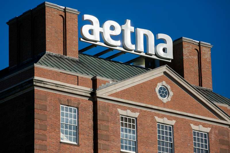 A logo sign outside of the headquarters of Aetna, Inc., in Hartford, Connecticut on November 21, 2015.
