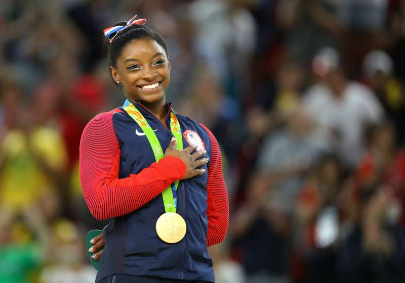 Gold medalist Simone Biles (USA) of USA places her hand on her heart as her national anthem is played after the Women's Floor Final in the 2016 Rio Olympics, Rio Olympic Arena, Rio de Janeiro, Brazil, August 16, 2016.