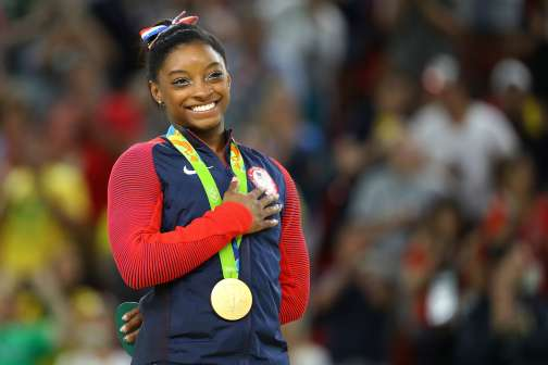 Here's What It Costs to Train Your Kid to Be the Next Simone Biles or Michael Phelps