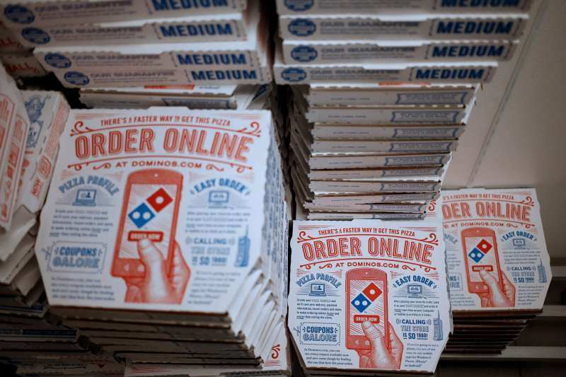 Pizza boxes sit stacked at a Domino's Pizza Inc. location in Murray, Kentucky, U.S., on Thursday,