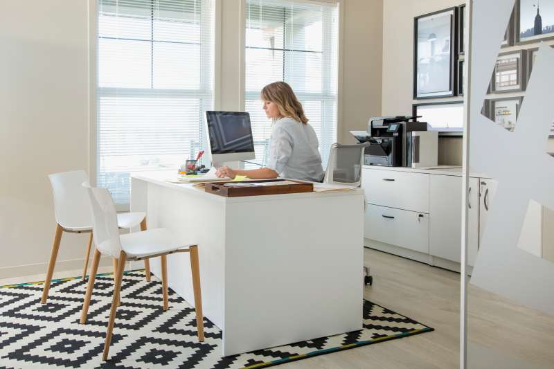 Woman working at computer in home office