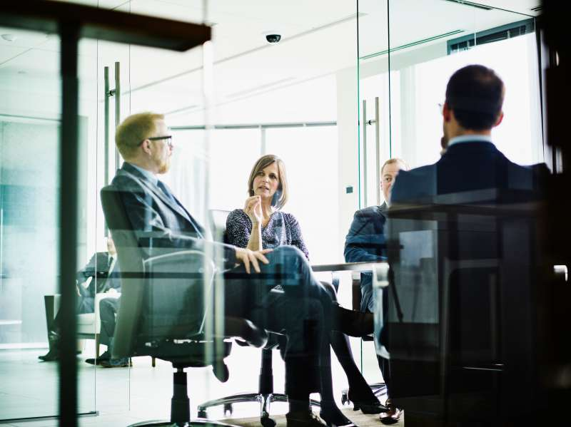 Female business executive leading meeting
