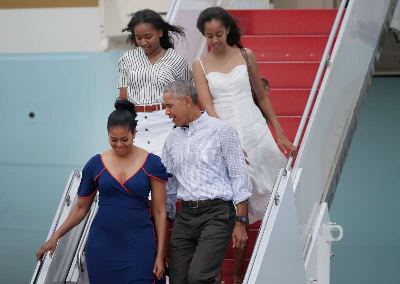 President Barack Obama, First Lady Michelle Obama, and their daughters, Sasha, back left, and Malia, step off Air Force One at Joint Base Cape Cod to take Marine One to Martha's Vineyard for a vacation, on Aug. 6, 2016.