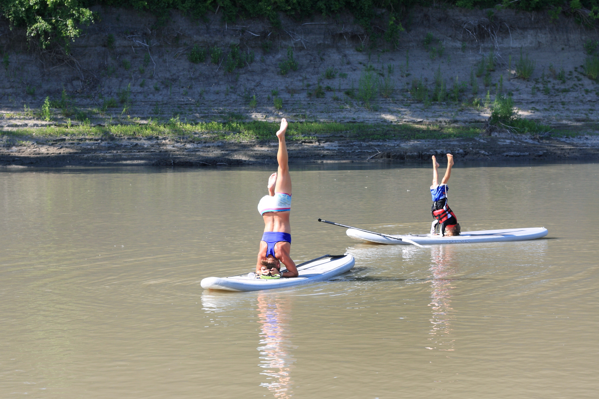 Grand Forks, North Dakota. Grand Forks is home to University of North Dakota, the Grand Forks Air Force Base, and a slice of the Red River, which is itself occasionally host to some very talented yoga practitioners.