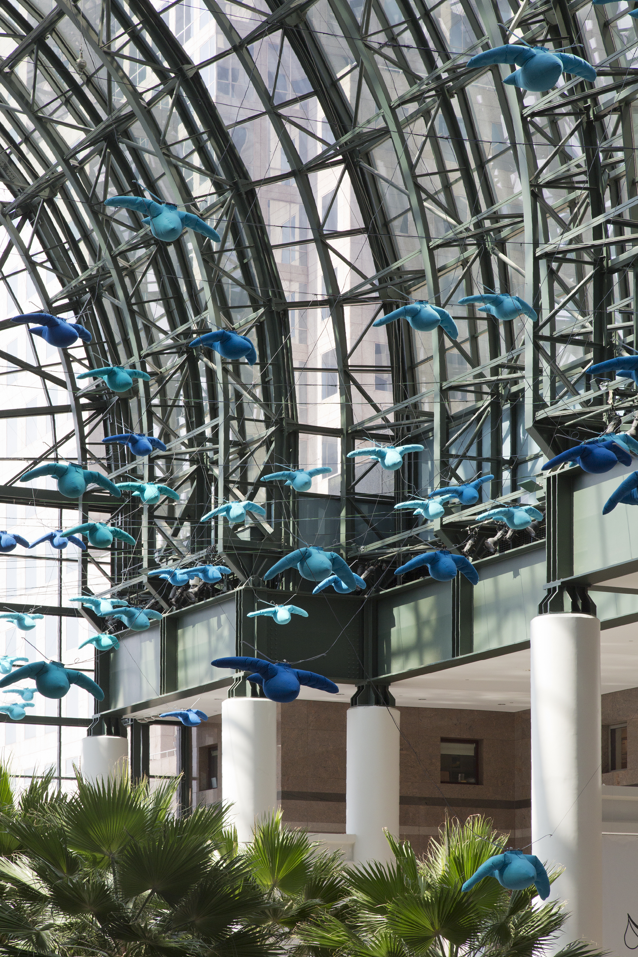 """""""Air Pressure,"""" a kinetic sculptural installation made out of fabric birds, is shown in the Winter Garden of Brookfield Place, New York. It was created by the Toronto-based artist collective Studio F Minus."""