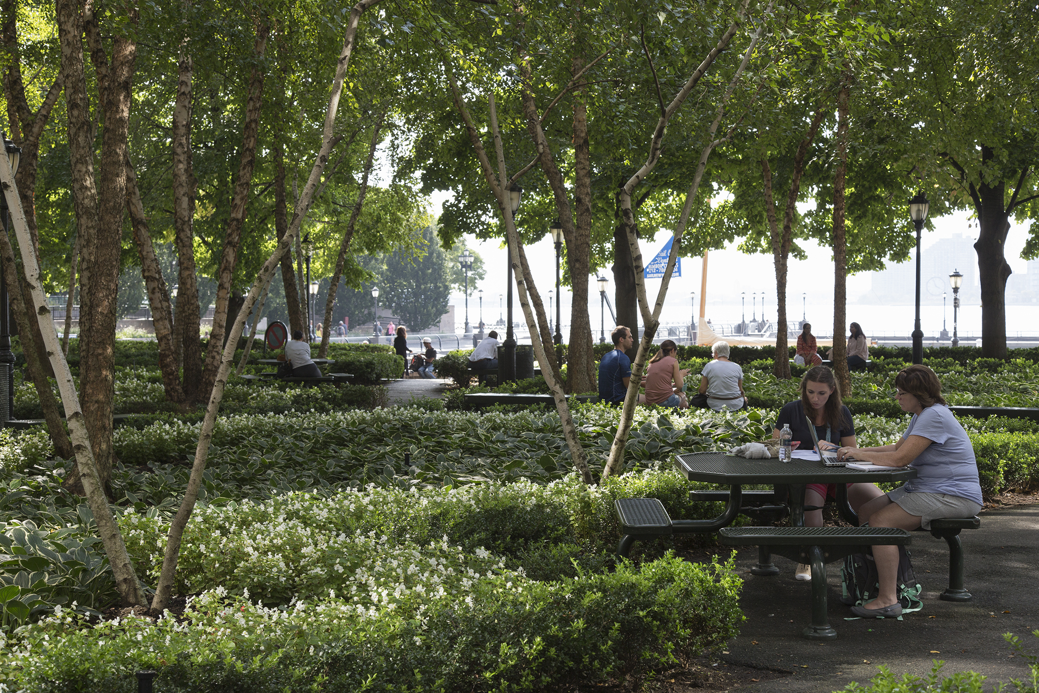 Freelancers work outdoors in Waterfront Plaza adjacent to Brookfield Place, New York.
