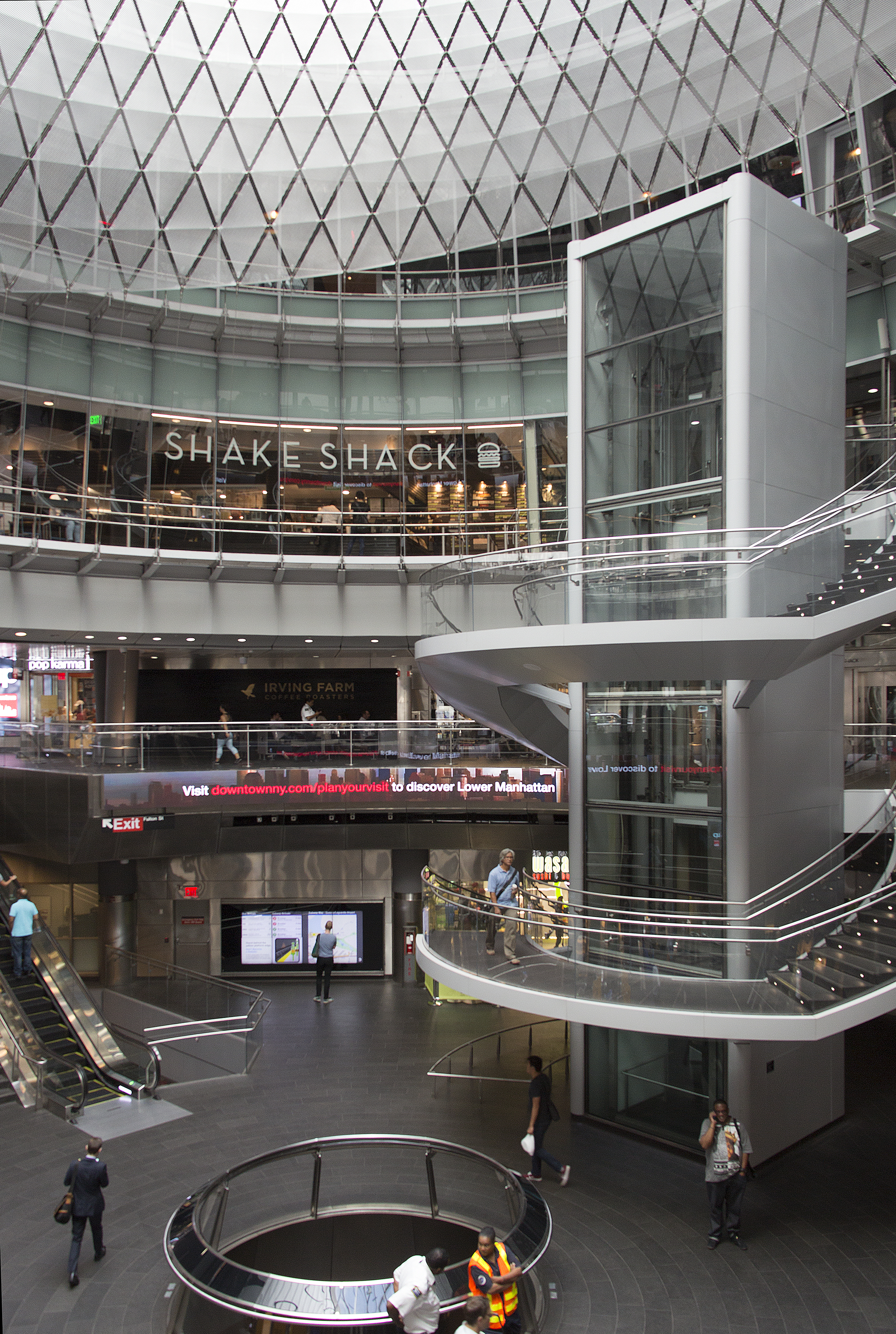 A view of the interior of Fulton Center featuring Shake Shack, Irving Farm and Wasabi Sushi & Bento, New York.