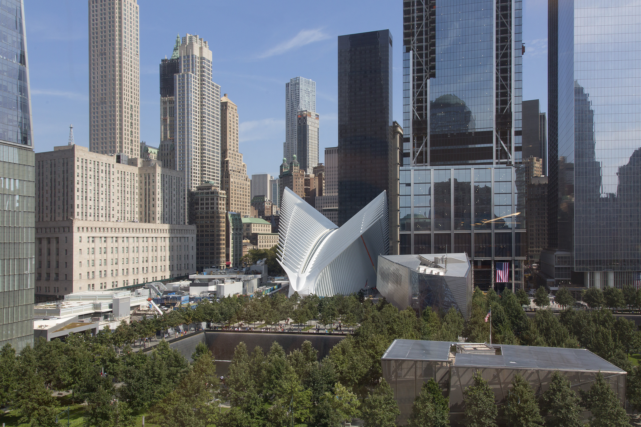 """""""Ground Zero"""" (shown fifteen years later), with Santiago Calatrava's World Financial Center transportation hub, the September 11 Memorial and Museum and 1 WTC visible, New York, September 8, 2016."""