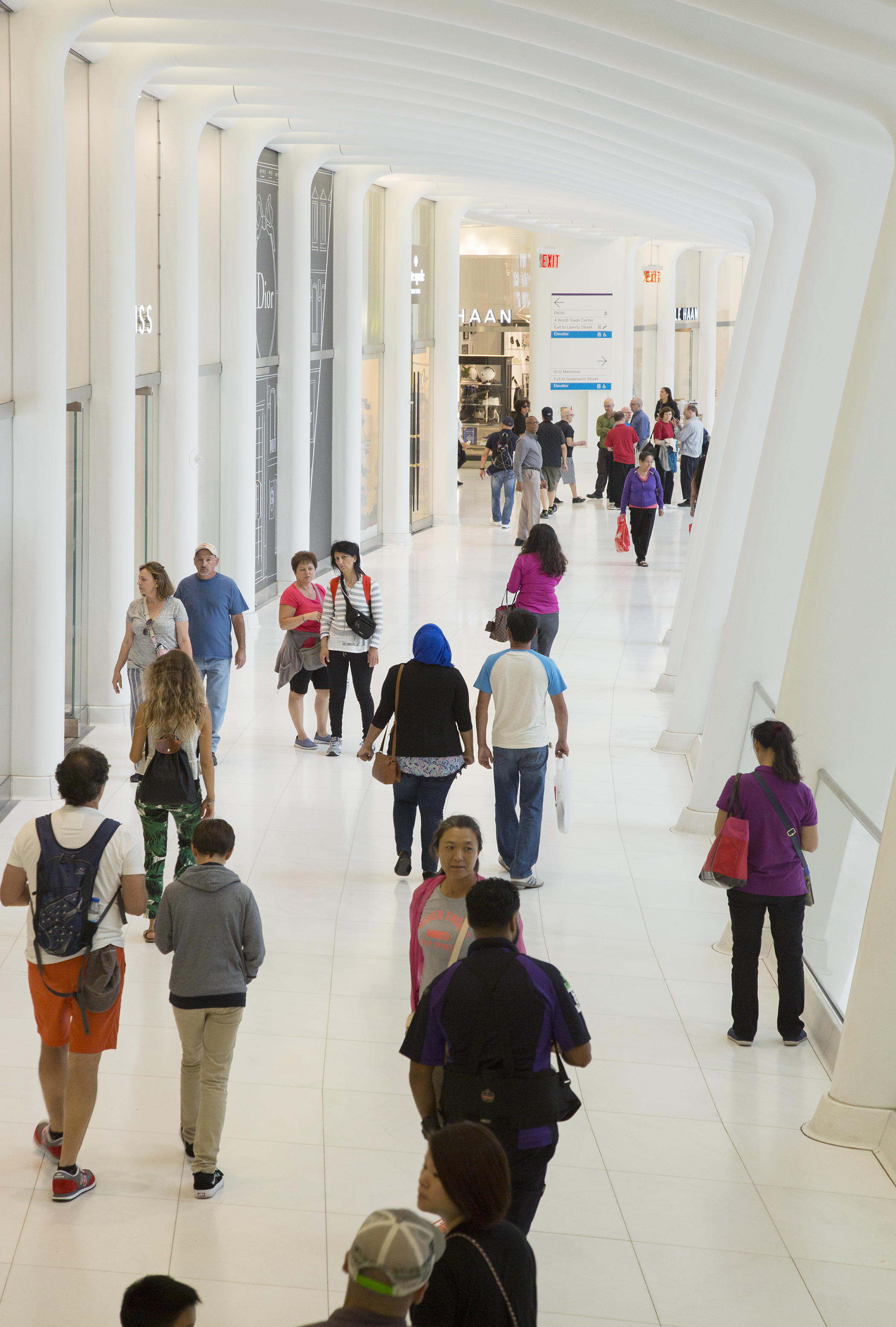 Shoppers walk through Westfield World Trade Center, which houses stores ranging from Banana Republic to Christian Dior, Kate Spade and John Varvatos.