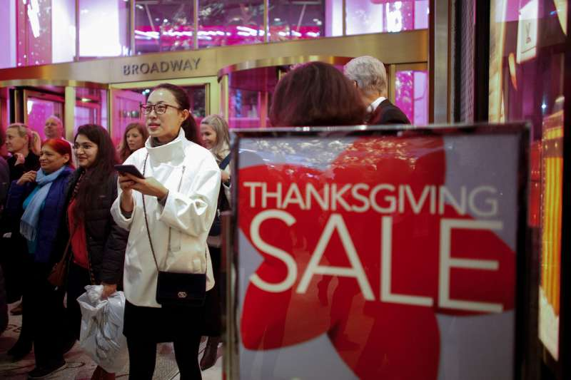 Customers stream into Macy's on Thanksgiving 2015.