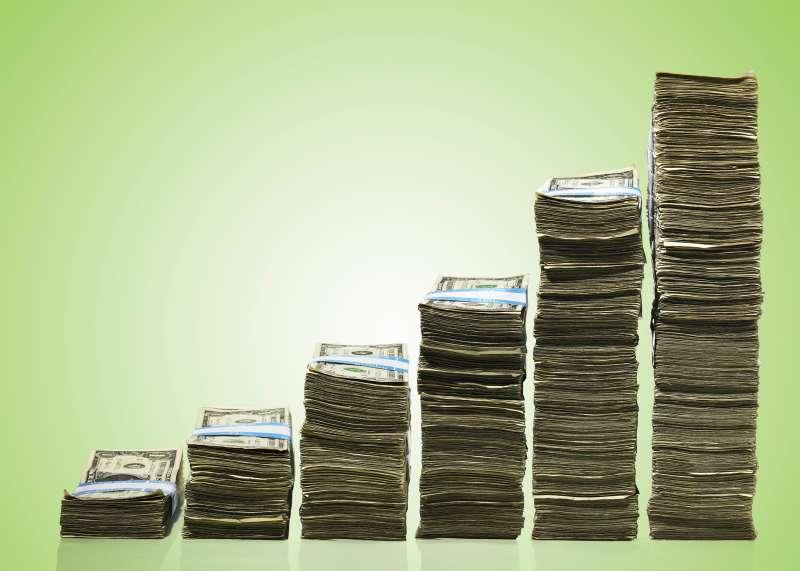 stacks of money increasing in height