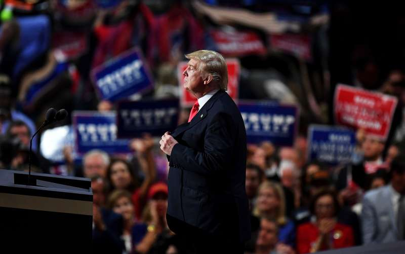 Republican presidential candidate Donald Trump pauses during his speech on the fourth day of the Republican National Convention on July 21, 2016 at the Quicken Loans Arena in Cleveland, Ohio.