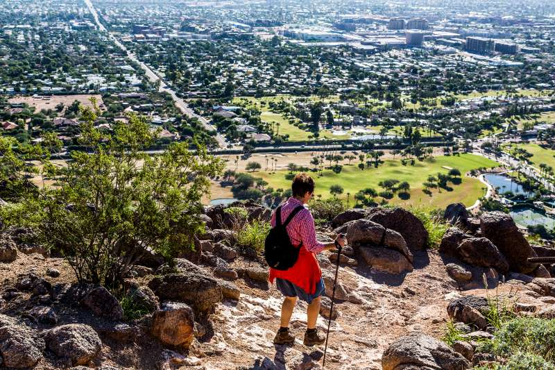 A woman in her mid thirties hiking the Cholla Trail above Scottsdale Arizona.