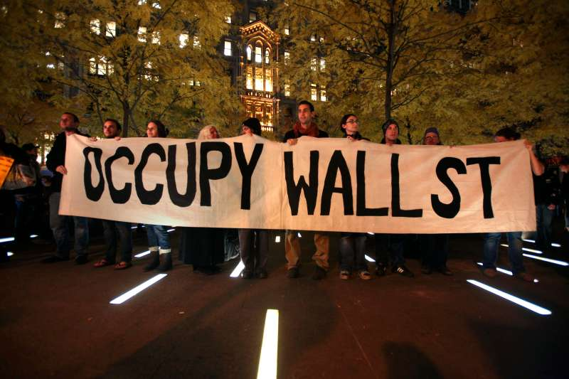 Members of Occupy Wall Street stand in Zuccotti Park.