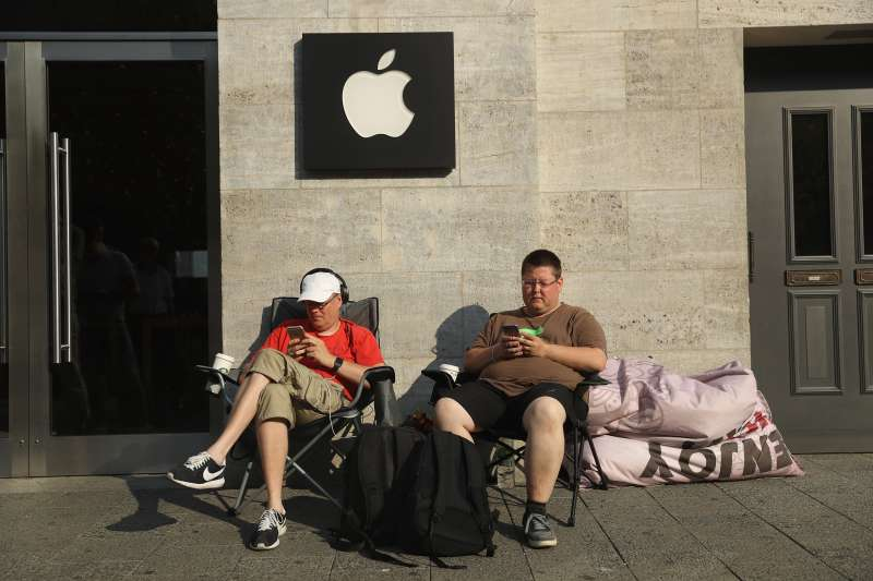 Two Apple fans camp out in front of the Berlin Apple store ahead of this coming Friday's sales launch of the new Apple iPhone 7 on September 14, 2016 in Berlin, Germany. Apple fans across the globe are awaiting the new phone despite its hefty retail price.