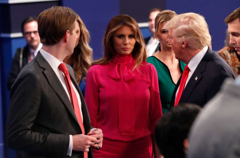 Republican U.S. presidential nominee Donald Trump talks with his son Eric (L), wife Melania (C) and daughter Ivanka (R, rear) at the conclusion of the debate with Democratic U.S. presidential nominee Hillary Clinton at Washington University in St. Louis, October 9, 2016.