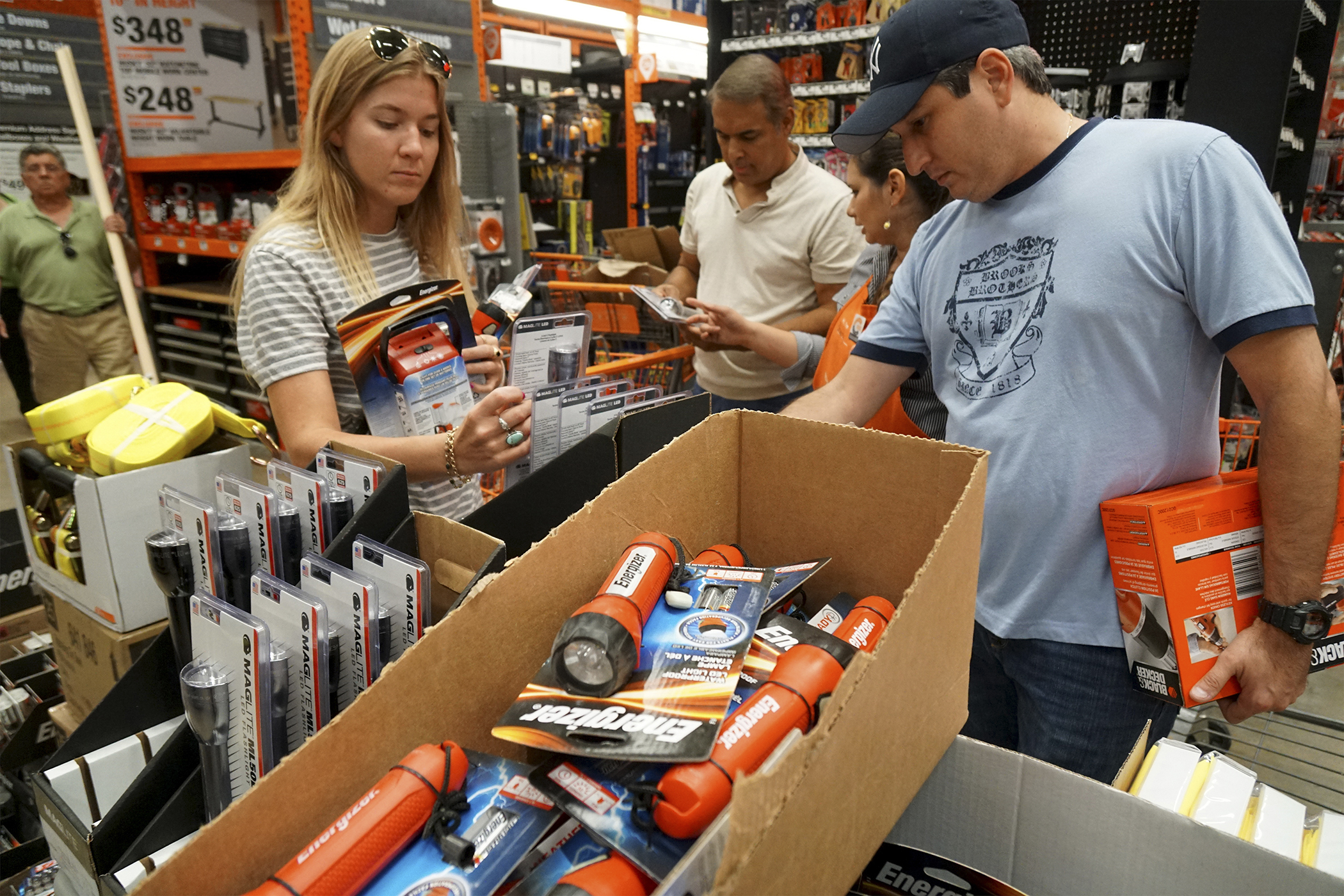 Customers shop for flashlights and batteries at a Home Depot Inc. store in Miami, Florida, on Oct. 4, 2016.