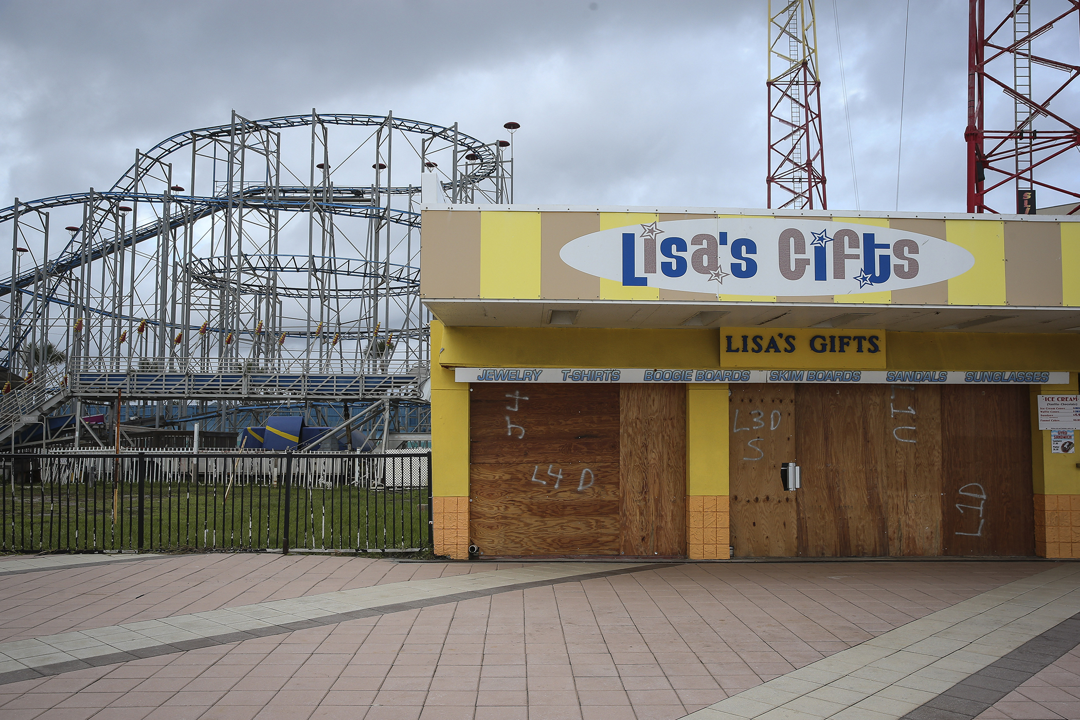 Lisa's Gifts at the Daytona Beach Boardwalk and Pier stands closed and boarded up ahead of Hurricane Matthew in Daytona Beach, Fla. on Oct. 6, 2016.