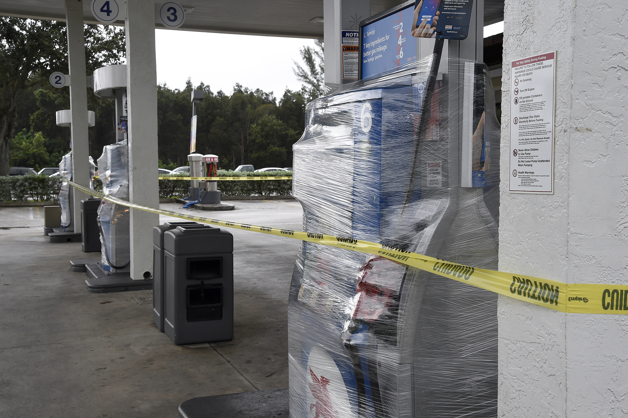 A gas station's pumps are wrapped and closed as many stations in south Florida are out of gas in Miami, Florida on October 6, 2016.