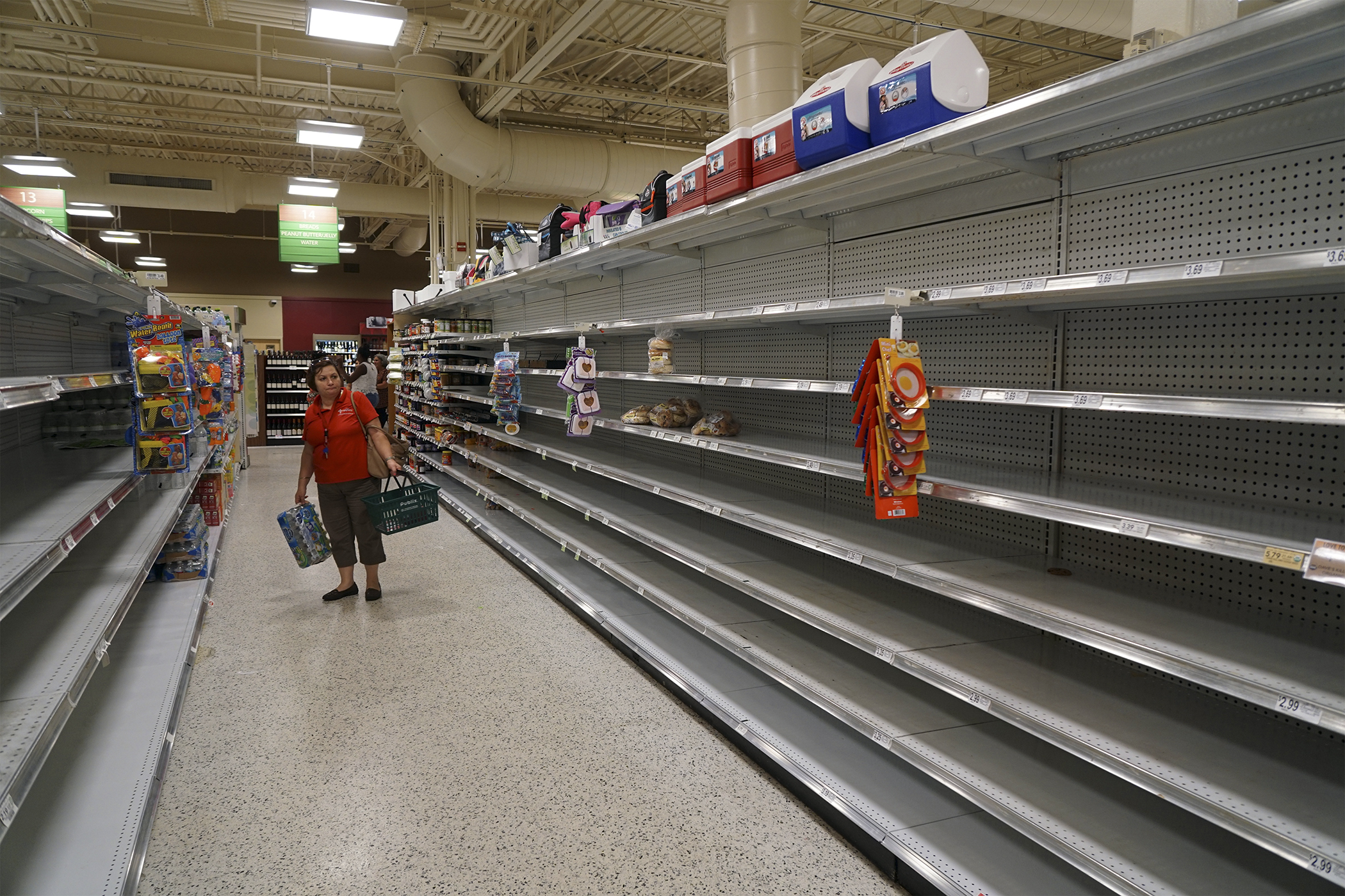 Customers browse empty shelves at a Publix Super Markets Inc. store ahead of Hurricane Matthew making landfall in West Palm Beach, Florida, on Oct. 5, 2016.
