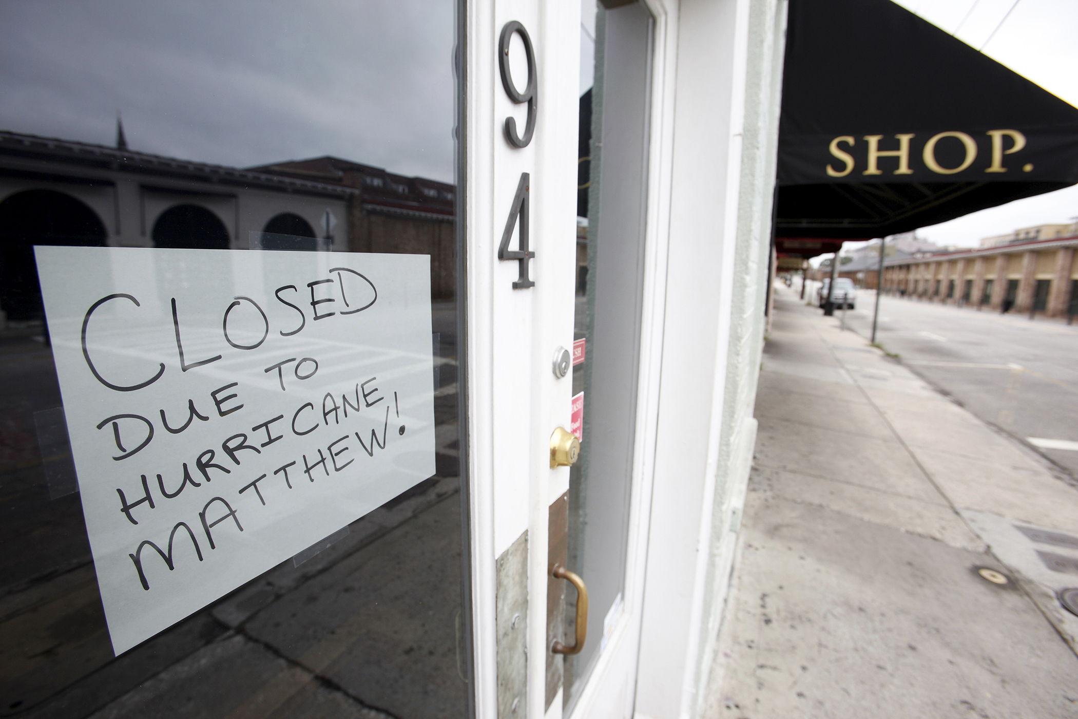 A sign in a shop window explains that they are closed due to the threat of Hurricane Matthew, in the mostly-empty historic district of Charleston, South Carolina on October 6, 2016.