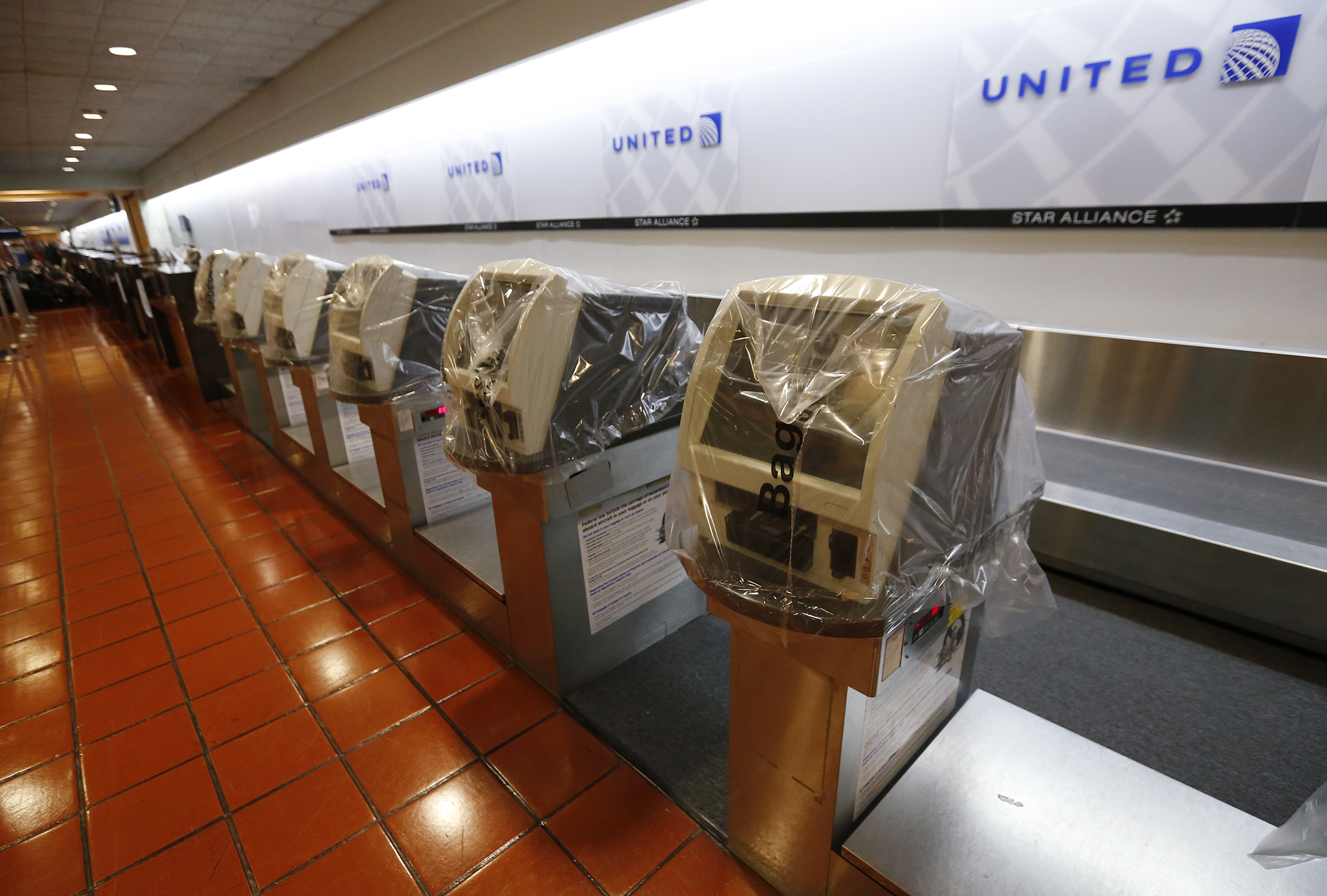 Ticketing machines are covered in plastic and flights in and out of the Palm Beach International airport in the afternoon as Hurricane Matthew advances, Thursday, Oct. 6, 2016, in West Palm Beach, Fla. The National Hurricane Center in Miami said the storm's maximum sustained winds had strengthened to 140 mph as of late Thursday morning and were expected to maintain their strength as the storm approaches the Florida coast.