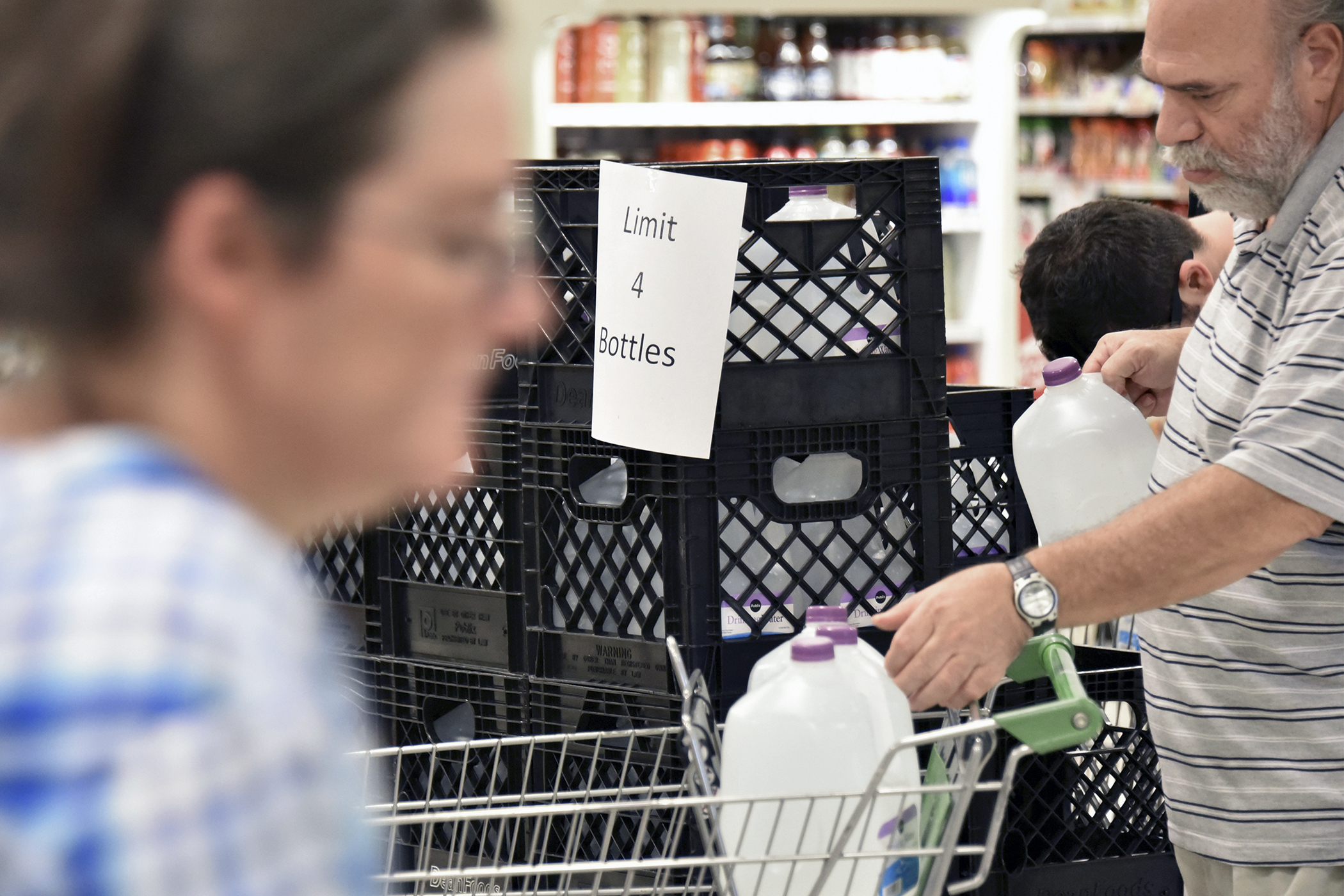A customer grabs Publix Super Markets Inc. brand purified water bottles at the company's store ahead of Hurricane Matthew making landfall in West Palm Beach, Florida, on Oct. 5, 2016. Hurricane Matthew has thousands fleeing the U.S. Southeast where its expected to batter the coastline and threaten electricity supplies to more than 1 million people. Potential losses are seen as high as $15 billion.