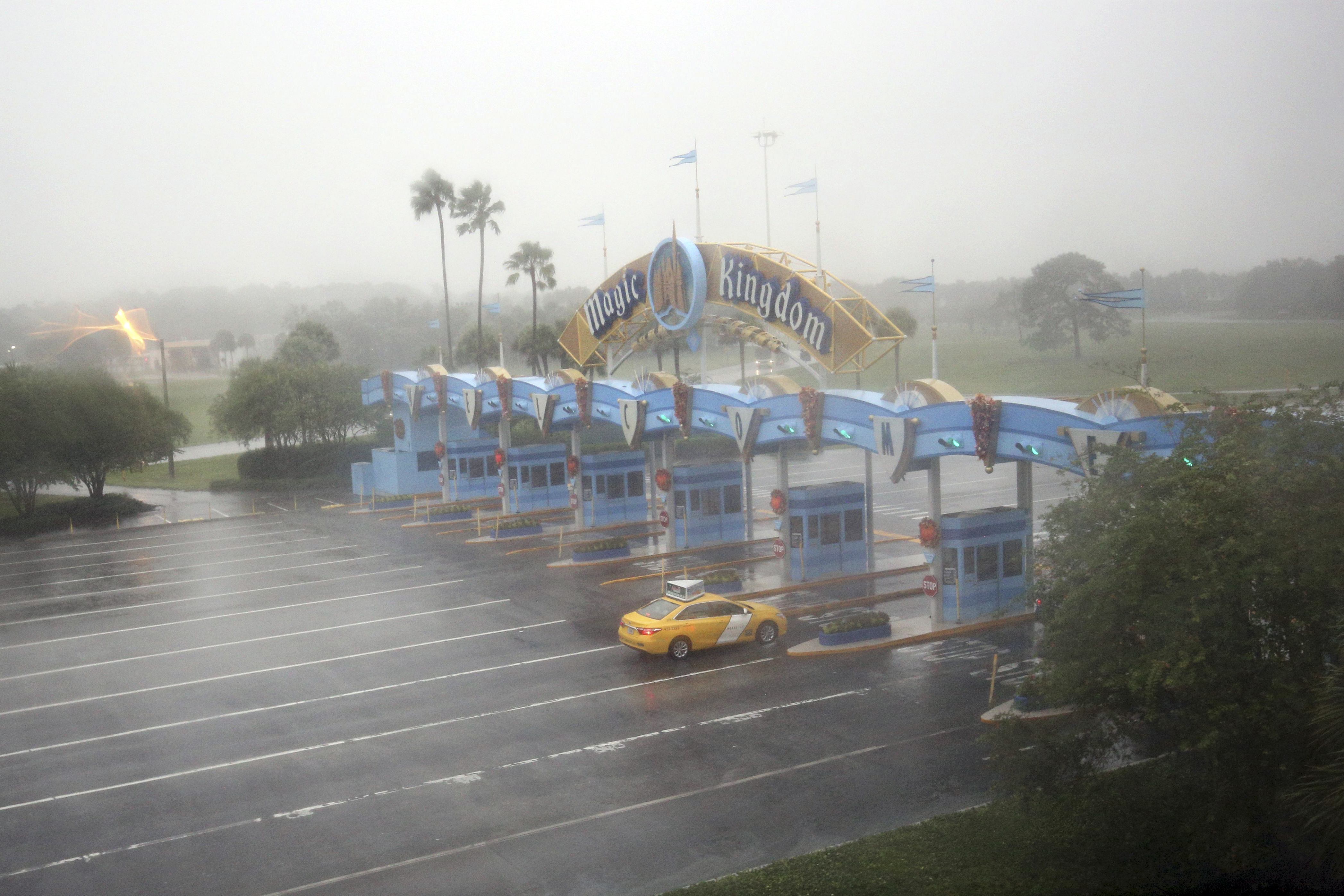 A lone taxi heads toward the Walt Disney World Resort area in Orlando, Florida, before the landfall of Hurricane Matthew, on October 6, 2016.