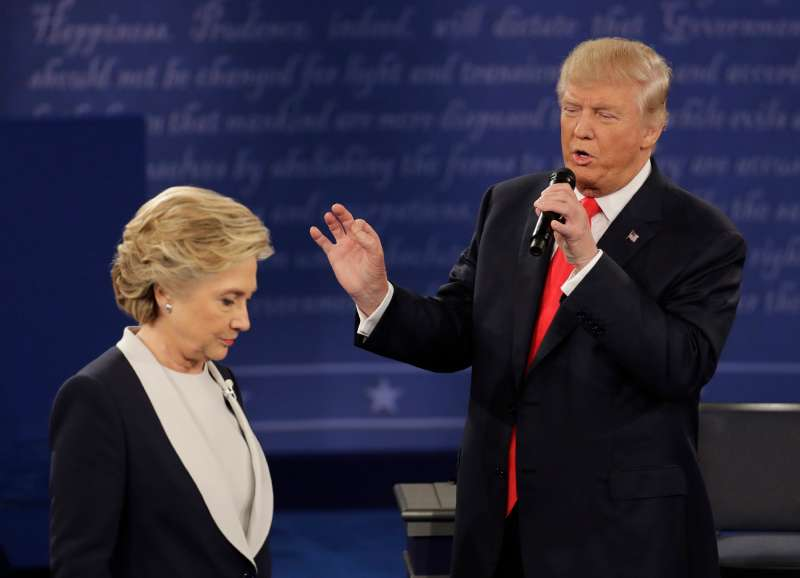 Democratic presidential nominee Hillary Clinton walks past Republican presidential nominee Donald Trump during the second presidential debate at Washington University in St. Louis, Sunday, Oct. 9, 2016.